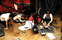 Performer &staff who repair shadowgraph during rehearsal リハーサルの間に影絵を修理する出演者やスタッフたち ⓒToshihiko Shibano
